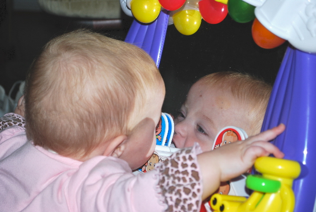 KISSIN' THE BABY IN THE MIRROR