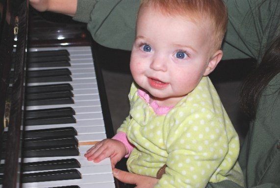Me, practicing my piano skills, and making magical music!