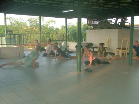 Volunteer-led yoga session on the roof of the PC office in Conakry.