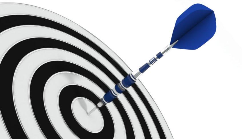 A dart in the bullseye of a dart board