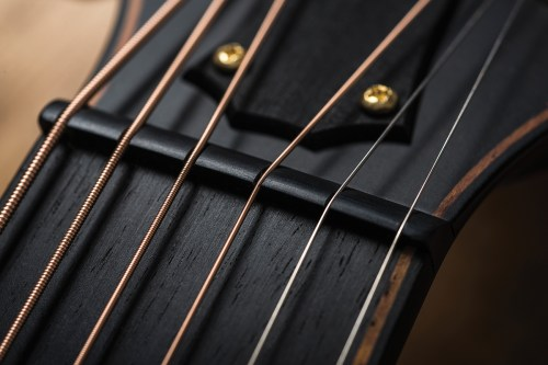 small resolution of the slanted alignment of the back braces is another notable feature of the guitar which powers explains that s a concept we introduced with some models