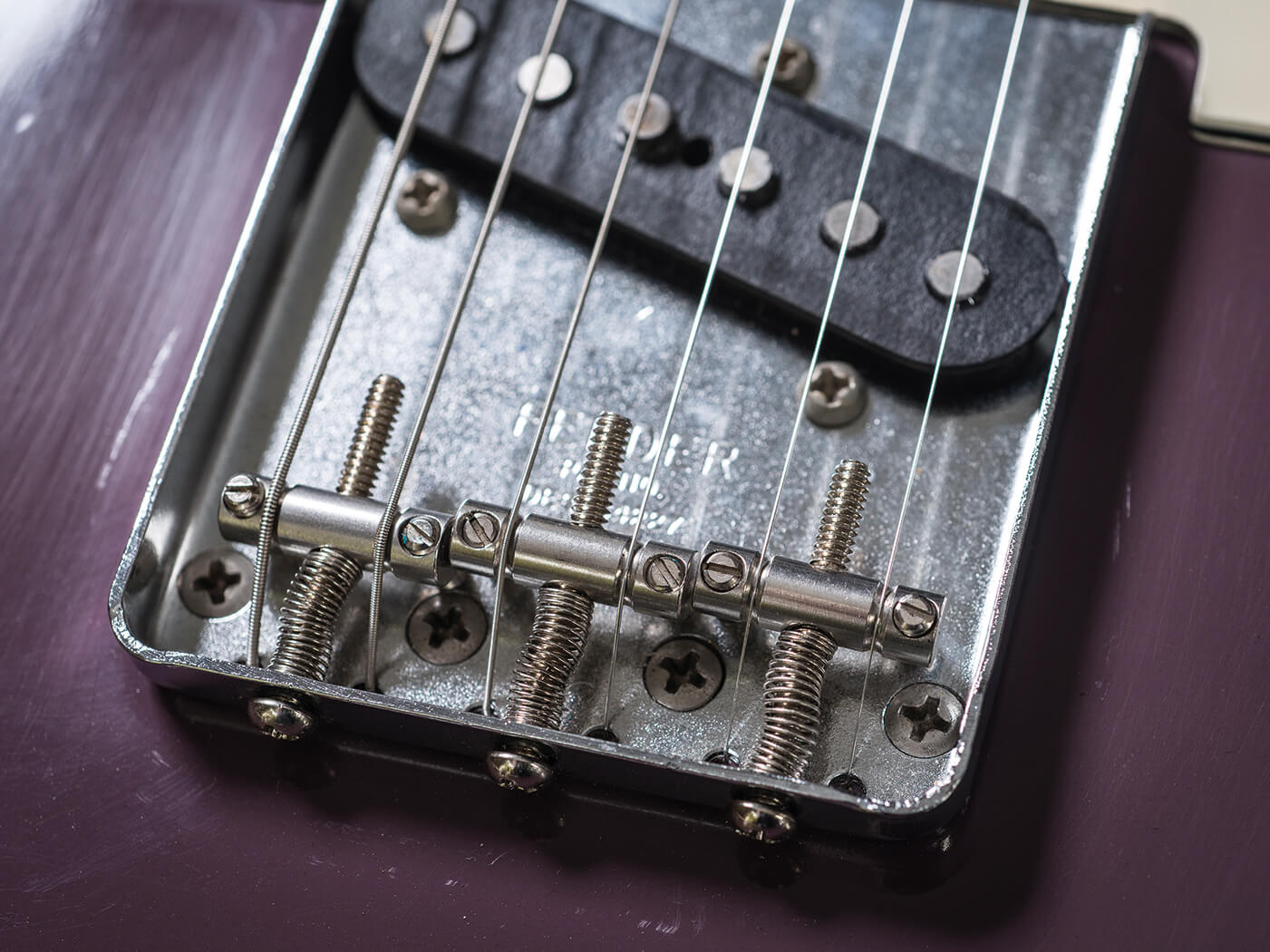 hight resolution of fender experimented with the materials of tele saddles almost from the start and the different metals will give different tonal outcomes