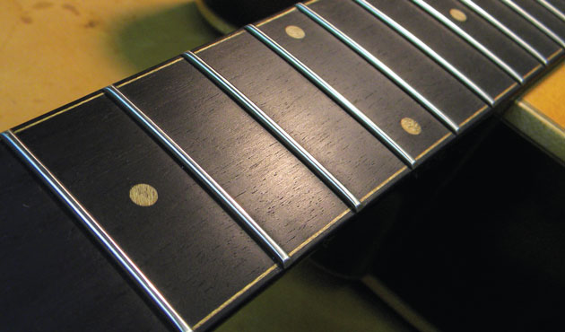 Clean the guitar Fretboard