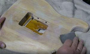 Puty and sanding guitar body