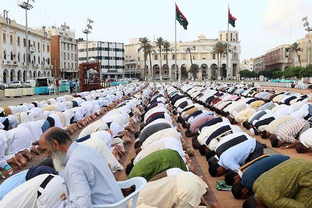 Muslim Libyan men perform the morning Eid al-Adha prayer on Martyrs' square in the capital Tripoli.