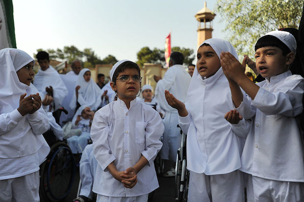 Iranian children reenact some parts of the haj pilgrimage, as Iranians marked the Eid Al-Adha Islamic tradition with the slaughter of hundreds of sheep at the Kahrizak Charity Foundation in Tehran.