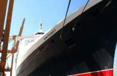 QE2's Glamorous Plans Scaled Back