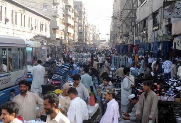 Garments are seen on sale by streetside