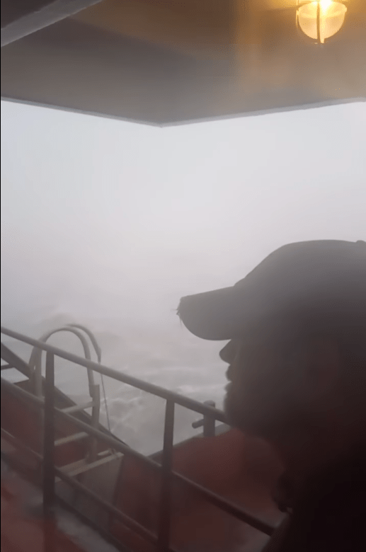 Capt. Newberry surveys the storm surge Hurricane Ida is bringing from the bridge of his supply vessel in Grand Isle, LA on Sunday August 29, 2021