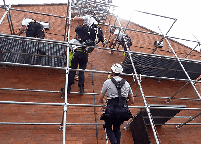 A scaffolding rig in use to provide training in work restraint, positioning and fall arrest.