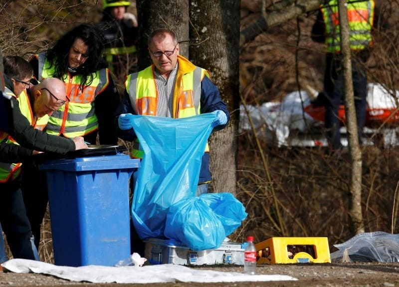 German police officers collect and register personal belongings of crash victims at the site of the two crashed trains near Bad Aibling in southwestern Germany, February 9, 2016. REUTERS/Michael Dalder