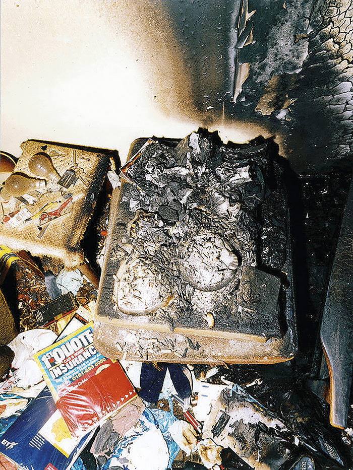 A fire caused by the careless disposal of cigarette ends.