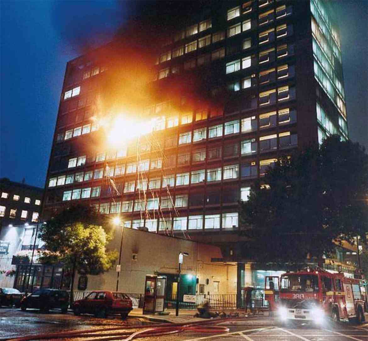 A 10 pump nightime fire in an office tower with firefighters working to contain the outbreak to three floors. Telstar House, Central London.