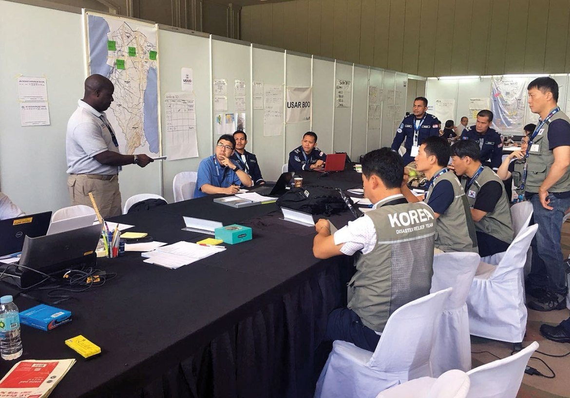Simulated coordination meeting during INSARAG Earthquake Response Exercise.