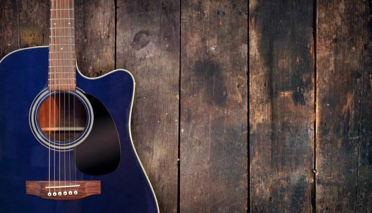 photodune-652099-acoustic-guitar-on-wood-m