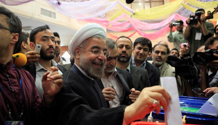 Presidential candidate Hassan Rohani casts his ballot during the Iranian presidential election in Tehran