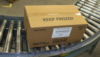 One of the first boxes of Vermilion Bay Sweet rolls off  the Gulf Crown packaging line.  Photo:  Ed Lallo/Louisiana Seafood News.