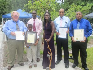Beaufort Mayor Billy Keyserling, Hilton Head Town Councilman Marc A. Grant and his son Moses, Mayor Samuel Murray of Port Royal, and Beaufort County Councilman William McBride stand proudly with the Gullah/Geechee Nation Appreciation Week Proclamations presented to Queen Quet, Chieftess of the Gullah/Geechee Nation (www.QueenQuet.com).