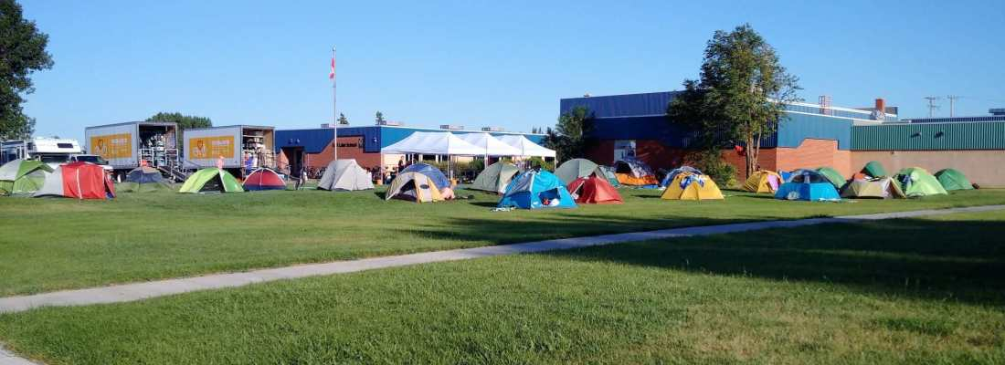 A Large Group of Cyclists Set Up Camp at the Gull Lake School GULL LAKE Health & Wellness  Gull Lake School Community Canada