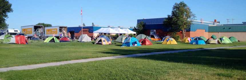 A Large Group of Cyclists Set Up Camp at the Gull Lake School GULL LAKE Health & Wellness  Gull Lake School Canada