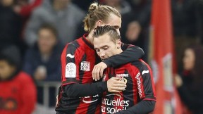 "Nice's swedish midfielder Niklas Hult (L) celebrates with Nice's French forward Eric Bautheac (R) after scoring during the French L1 football match Nice (OGC Nice) vs Marseille (OM) on januay 23, 2015 at the ""Allianz Riviera"" stadium in Nice, southeastern France. AFP PHOTO / VALERY HACHE (Photo credit should read VALERY HACHE/AFP/Getty Images)"