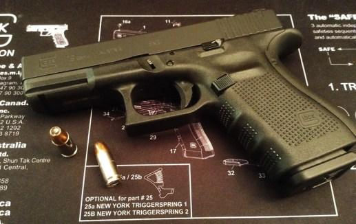A Gen4 Glock 19 sitting on a Glock part breakdown mat.