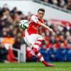 Özil slots a free kick against Liverpool