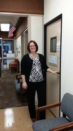 Above: Assistant Principal Heather Clary-Wheeler stands outside of her office in Gunn's main office.