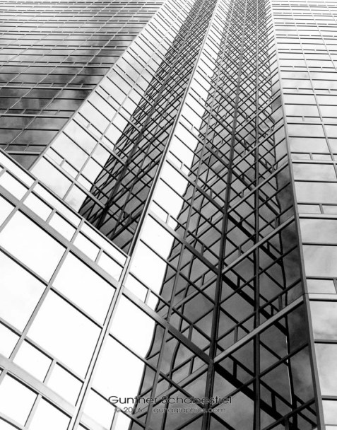 Verticle lines create a visual pattern on a glass clad building.120 6x4.5 Black & White