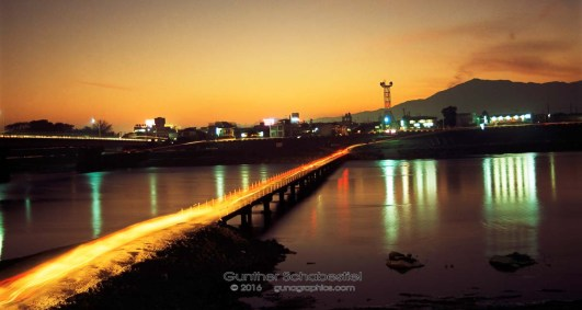 A small City in Japan is lit up by the evening dusk. 120 6x6 Color Film