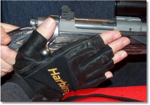 The hand rotates forward while using the base of the thumb to push the bolt forward; the next round is stripped from the magazine and is fed into the chamber.