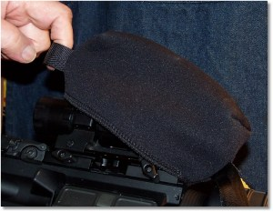 Pull the Rear Tab of the Scopeshield to Take It Off or to Put It On.