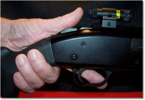 The top-mounted laser, and Mossberg top-mounted safety, allows for easy activation with the thumb