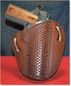 The Springfield 1911 Loaded in a OWB Holster by Leather Creek Holster of Gainesville, Georgia.  I used this holster in a recent training course and it is an excellent holster