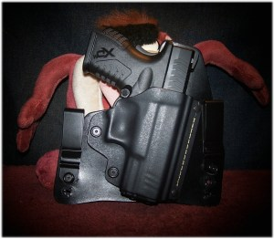 The Springfield XDm 3.8 Compact 45 At Home in a Black Arch Holster