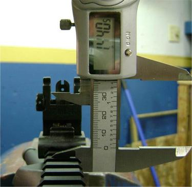 """Rear sight, approximately 1.440"""" from top of rail to aperture"""