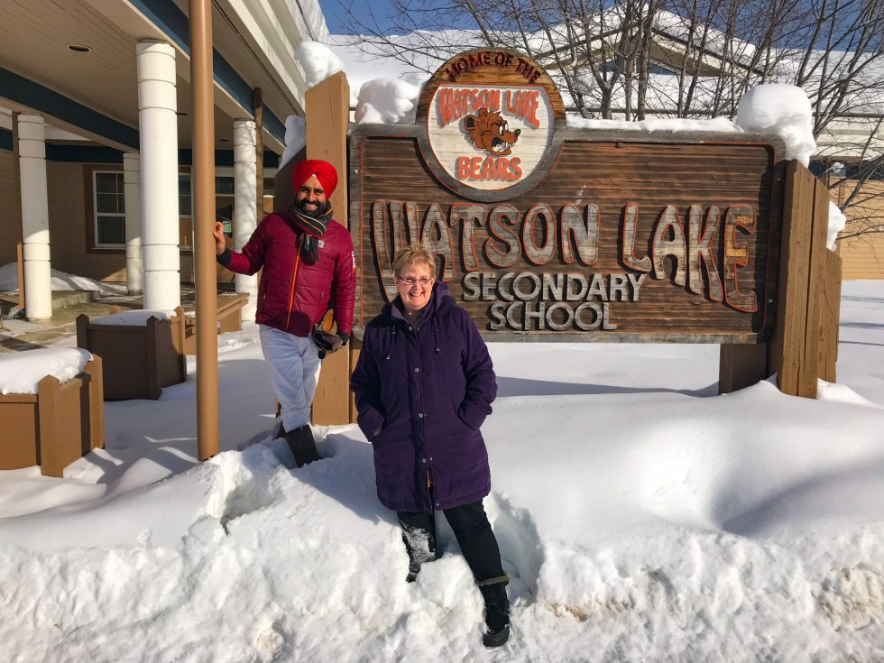 Gurdeep Pandher and Sue Rudd from Watson Lake Community Hospital outside of the Watson Lake Secondary School