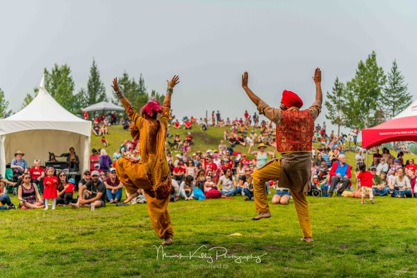 Canada Day 2019 Bhangra in Whitehorse, Yukon by Gurdeep Pandher and Ana Rita Gracia. Photo by: Mark Kelly Photography