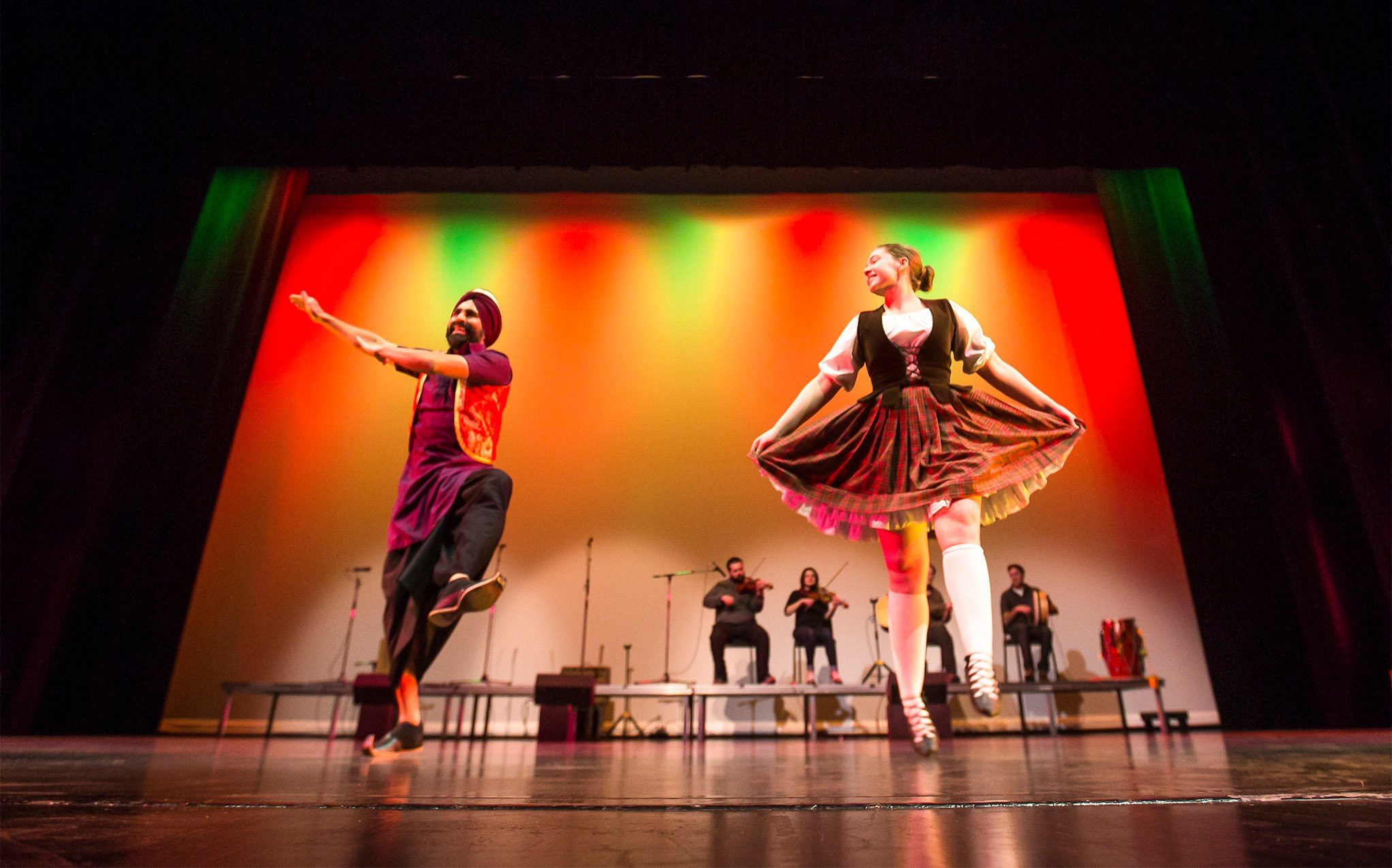 Gurdeep Pandher and Brianna Heal dance a bhangra/highland dance mashup during the Bhangra - Dance of Punjab show at the Yukon Arts Centre in Whitehorse on Dec. 18, 2018 | Photo by: Crystal Schick/Yukon News