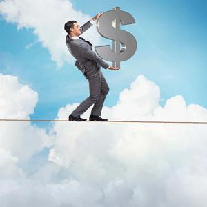 An accountant is balancing money while walking on a rope representing about Gurian CPA Firm