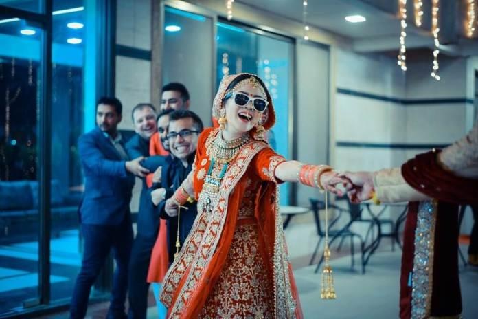 bride-laughing-fun-wedding-photo