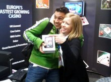 Roy Hen accepting his new Samsung Galaxy from GuruPlay Affiliate Manager Christine Lamain