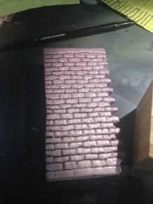 I scribed a brick pattern into pink insulation foam.