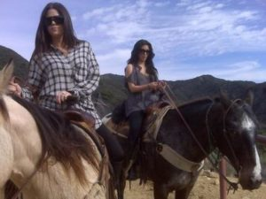 Kim Kardashian and Khloe Kardashian - Celebrities who love horses