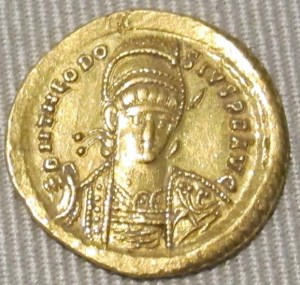 Solid gold coin with the face of Theodosius II