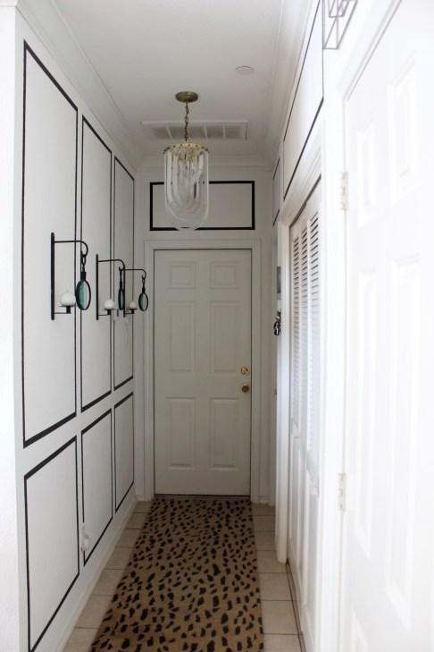 Leopard Rug Black and White Moulding Vintage Lucite Ribbon Chandelier