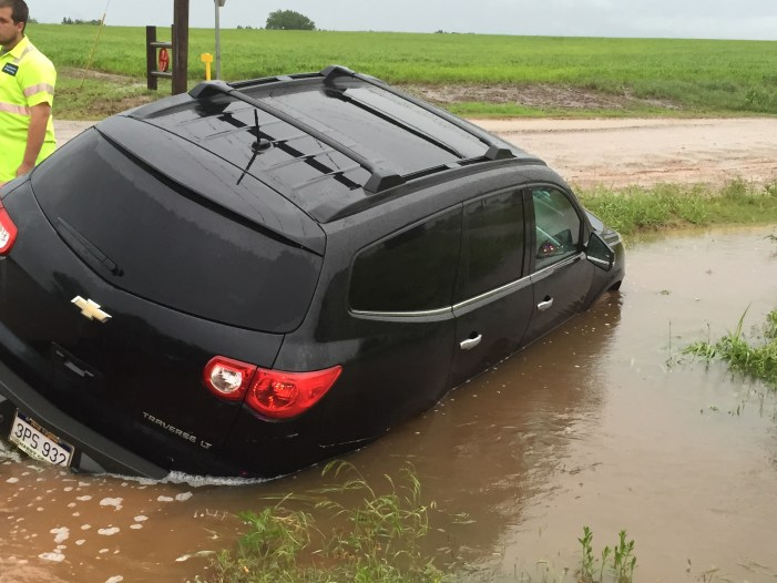 Car fills up with water after falling in ditch