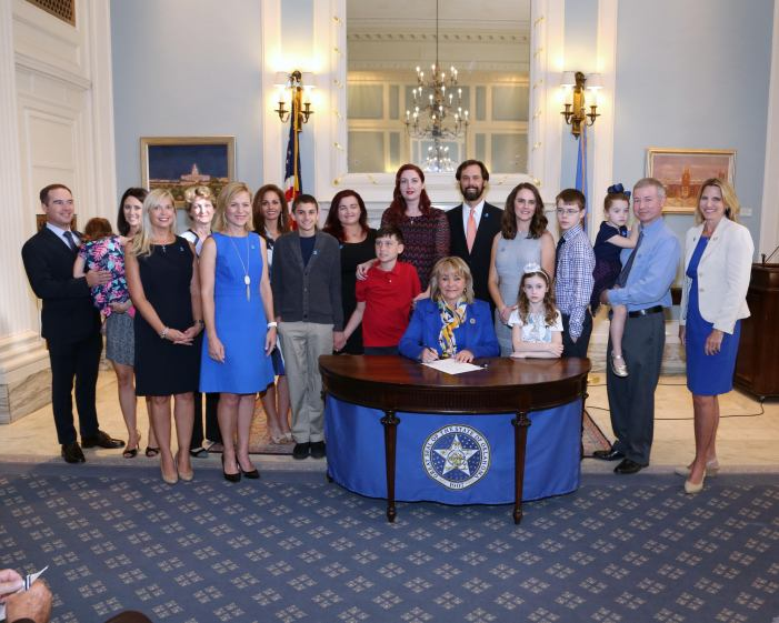 Ceremonial signing held for bill requiring insurance to cover autism