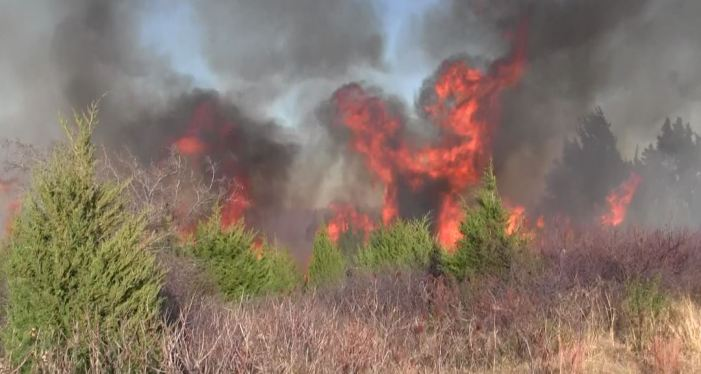 Evacuations underway for large grass fire in SE Logan County