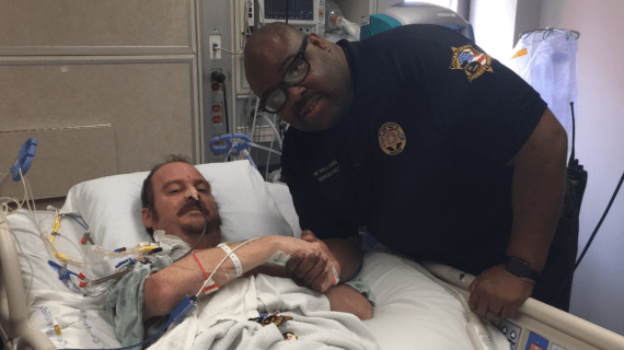 Sean Case shakes the hand of his LCSO hero